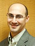 Headshot of a smiling Joseph Tranquillo