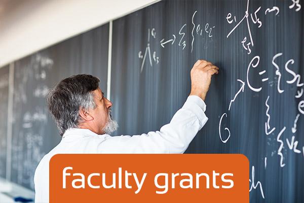 Professor writing on chalkboard. VentureWell Faculty Grants title.